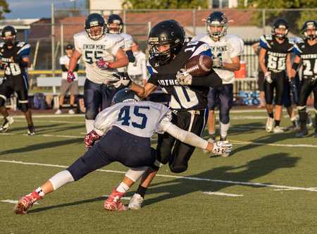 Football action at University Prep High School in Redding, California.