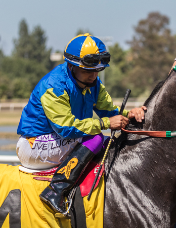 pace: Horse racing action at the Cal Expo Track  in Sacramento, California. July 17, 2017.