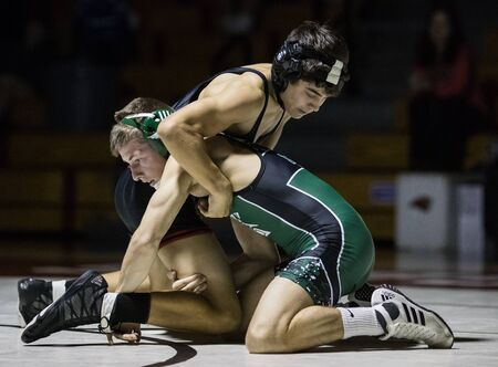 Wrestling action with Red Bluff vs. Foothill High School under the spotlight in Palo Cedro, California. Editorial