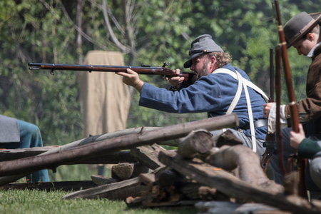 American Civil War reenactors in action at the Dog Island event in Red Bluff, California.