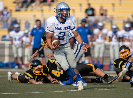 Football action with McQueen High School vs. Enterprise in Redding, California.
