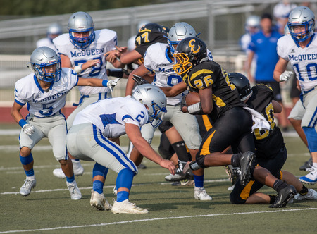 Football action with McQueen High School vs. Enterprise in Redding, California. 新闻类图片