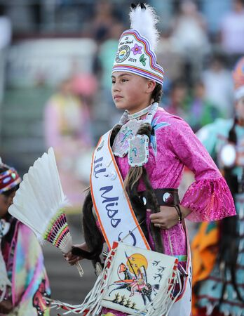 Dancers perform during the Grand Entry of the Julyamsh Pow Wow in Coeur d`Alene, Idaho. Stok Fotoğraf - 134994112