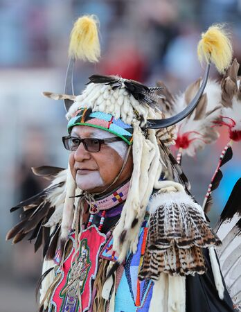 Dancers perform during the Grand Entry of the Julyamsh Pow Wow in Coeur d`Alene, Idaho. Stok Fotoğraf - 134994132