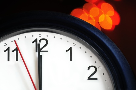 nearly: Office clock about to show midnight - few seconds to New Year