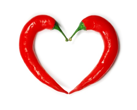 spice isolated: Two chili peppers forming a shape of heart  Hot lover symbol