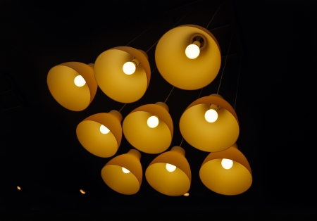 Set of ceiling lamps hanging on long cords in the darkness Stock Photo - 13847955