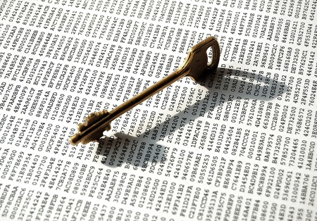 Key on a sheet with encrypted data Stock Photo - 13848040