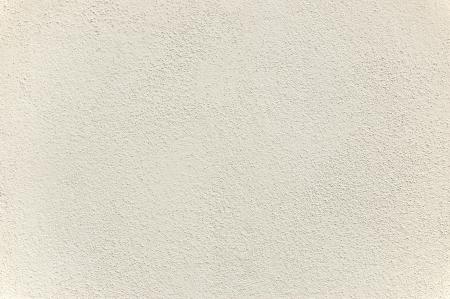 따뜻한 톤의 흰색 회 반죽의 질감