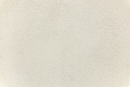 Warm toned white stucco texture photo