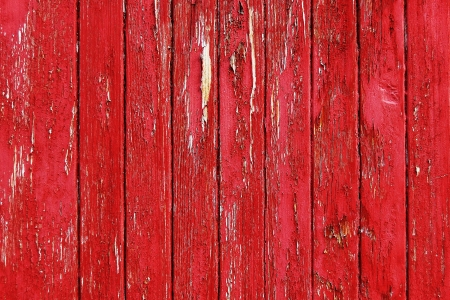 Red painted threadbare wooden plank photo