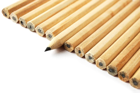 dissident: A row of graphite pencils with one in different position as a symbol of difference and opposition Stock Photo