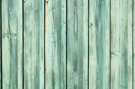 Light blue-green painted weathered wooden fence texture photo