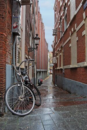Narrow street in the Amsterdam center on a rainy day photo