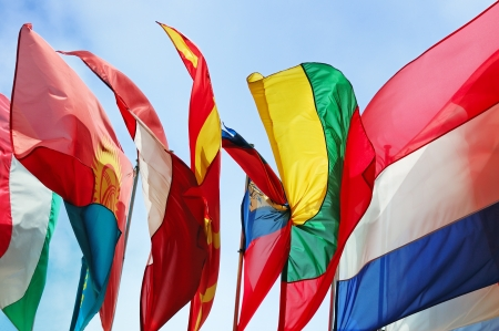Flags of several Europe states against blue sky Stock Photo