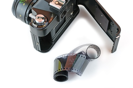 ttl: Close-up view of a opened classic manual SLR film camera with twisted film isolated on white background Stock Photo