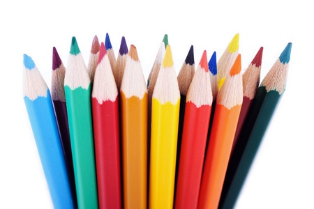 saturated color: Colored pencils placed in random order isolated on white background