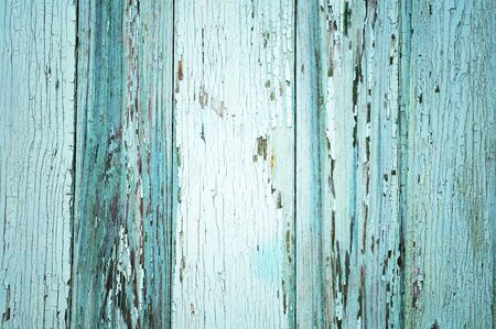 Light blue painted threadbare wooden plank