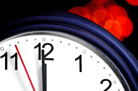 end month: Office clock about to show midnight - few seconds to New Year