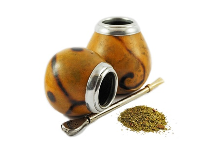 mate drink: Two yerba mate gourds isolated on white Stock Photo