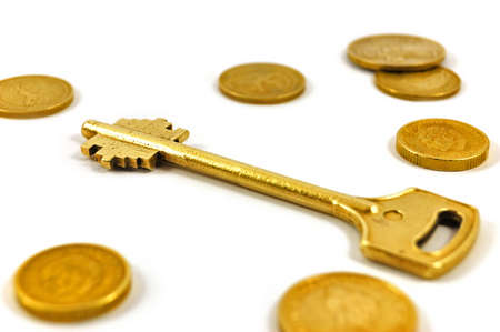 Golden key with coins symbolizing secure investment photo
