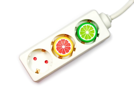 invigorate: A power extension cord with plastic caps from juice bottles. Energy drink concept. Stock Photo