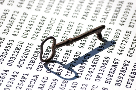 encrypted: Old-fashioned rusty iron key on a sheet with encrypted data Stock Photo