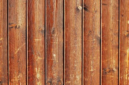 Scratched unfinished wooden fence texture photo
