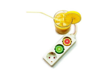 invigorate: A power extension cord with plastic caps from juice bottles and glass of juice. Energy drink concept.