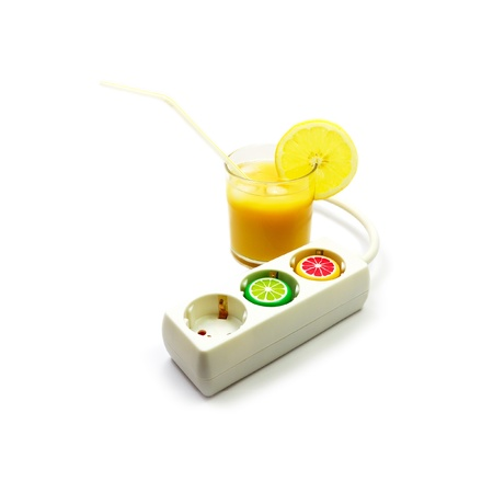 invigorate: Power extension cord with plastic caps from juice bottles and glass of juice. Energy drink concept.