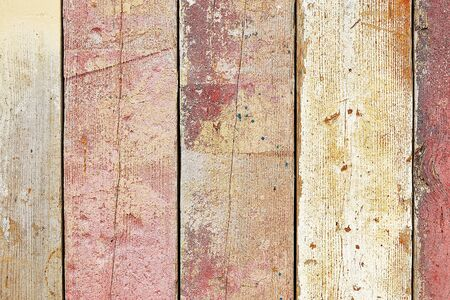 Weathered multicolored wooden fence texture photo
