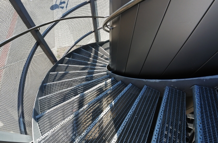 banister: Metal spiral staircase near a modern building  Spiral stairs as an contemporary architectural element  Stock Photo