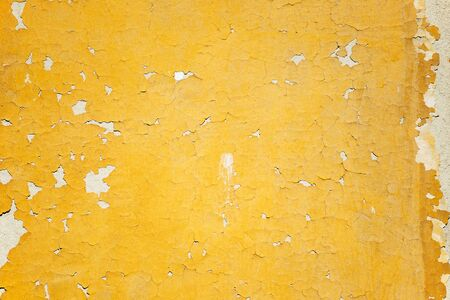 parget: Fragment of tumbledown yellow painted stone wall Stock Photo