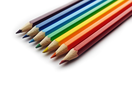 saturated color: Colored pencils arranged in rainbow spectrum order isolated on white background