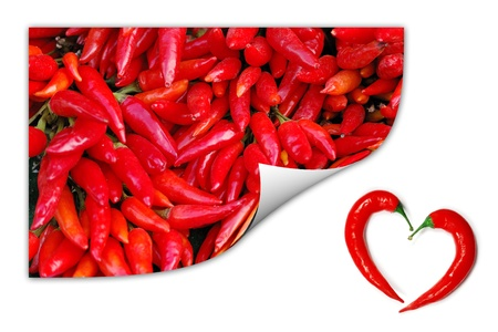 A pile of red chili peppers picture with two peppers forming a shape of heart. Hot lover symbol. photo