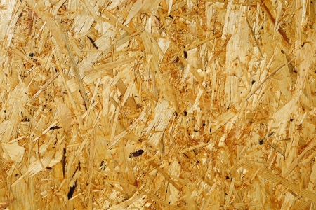 Fragment of wooden fibreboard panel surface; may be used as a seamless background photo