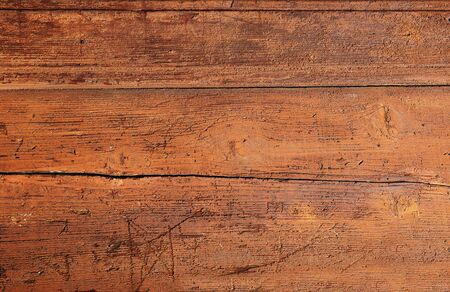 Cracked weathered brown painted wooden board texture photo