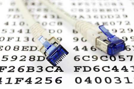 ethernet cable: Network patch cable against a sheet with an encryption key