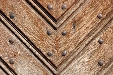 durable: Fragment of durable wooden gate in old castle