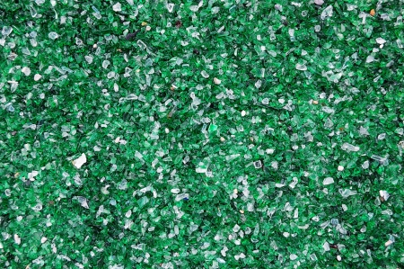 Broken emerald green and white glass pieces suitable for background