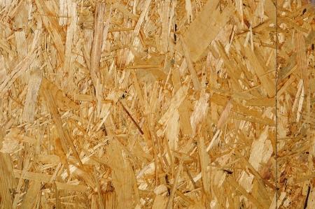 나무 섬유판 패널 표면의 조각; 원활한 배경으로 사용할 수 있습니다