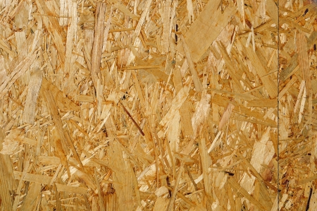Fragment of wooden fibreboard panel surface; may be used as a seamless background
