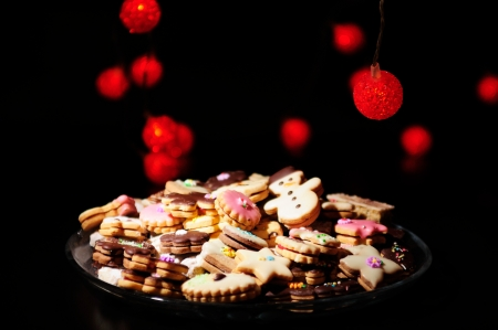 Christmas cookies and cakes in warm lights photo