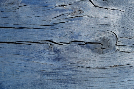 chink: Dark blue cracked wooden boarding
