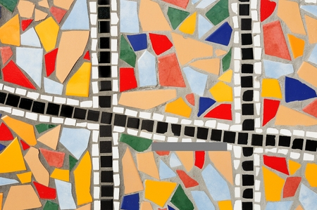 Multicolored broken mosaic tile abstract pattern background photo