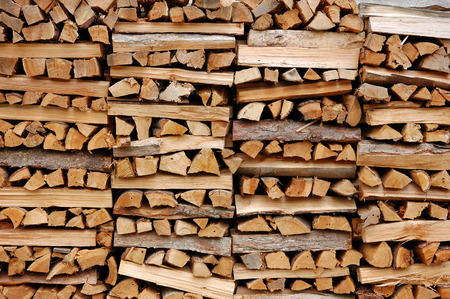 warmth: Pile of wood cut for fireplace Stock Photo