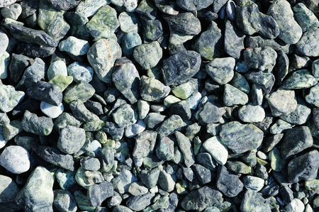 pebblestone: Speckled peeble stones surface as natural background