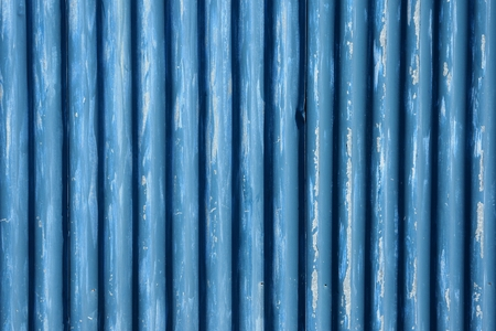 corrugate: Corrugated metal sheet fence with peeling away paint