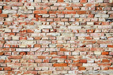 Fragment of a wall made of rough bricks Stock Photo