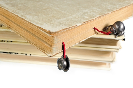 Stack of used books with a hand-made bookmark